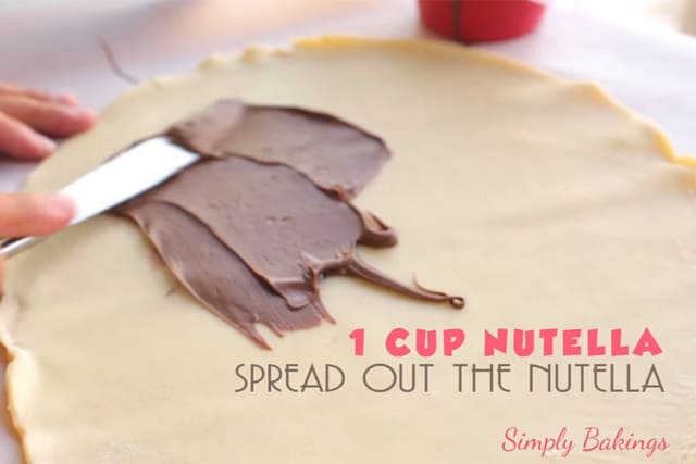 spreading nutella on pie crust using a bread knife