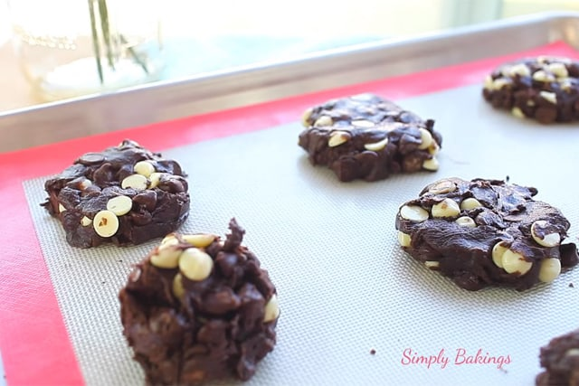 ready to bake double chocolate chip cake mix cookies on a cookie sheet