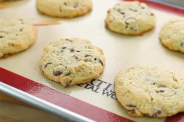 freshly baked cream cheese chocolate chip cookies on a cookie sheet