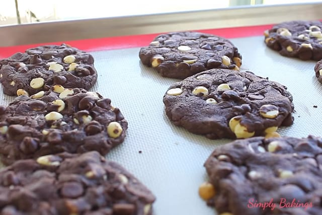 freshly baked double chocolate chip cake mix cookies on a cookie sheet