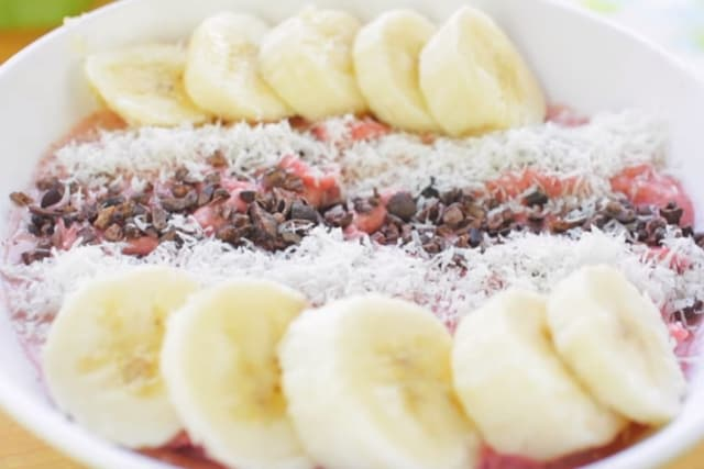 strawberry smoothie with bananas, coconut and cocoa nibs