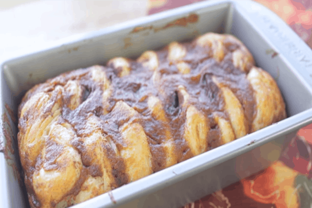 freshly baked pumpkin pull apart bread in a loaf pan