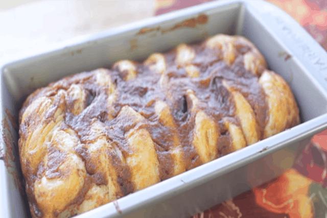 freshly baked pumpkin pull apart bread in a loaf pan
