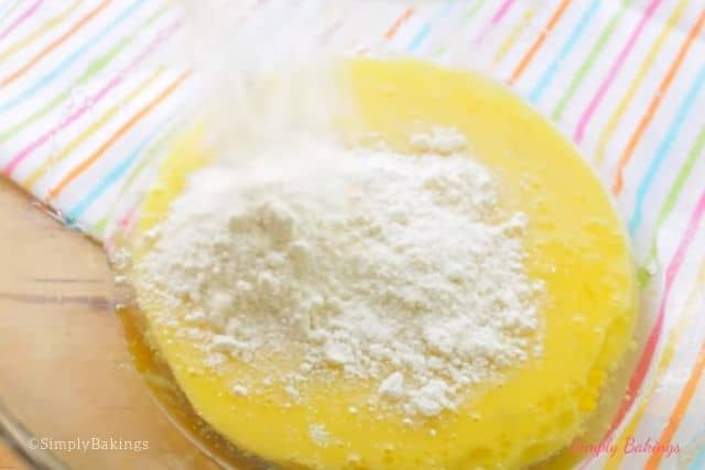 mixing lemon cake mix to eggs and oil mixture