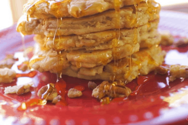 stack of butter pecan pancakes glazed with maple syrup
