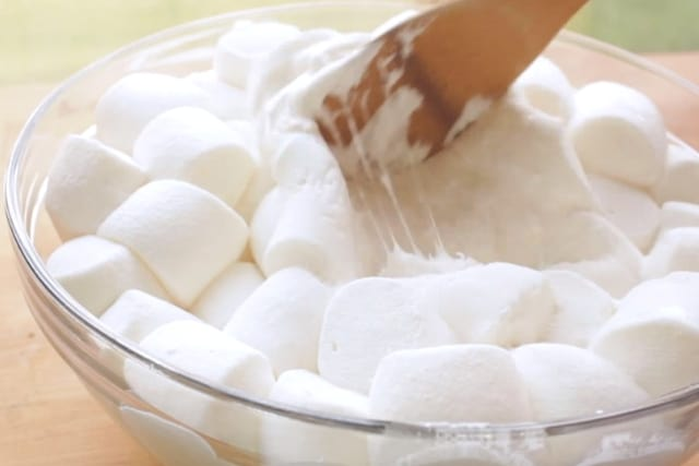 melted marshmallows mixed with a wooden spatula