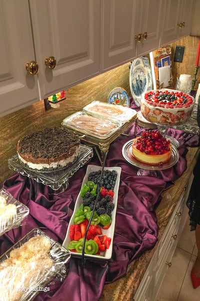 3 Ingredient no bake oreo cheesecake with other Christmas desserts in a buffet