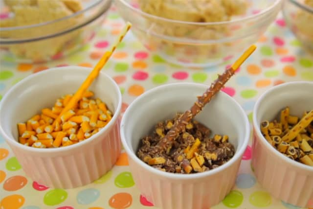 orange, coconut chocolate and chocolate flavors of pocky sticks in separate bowls