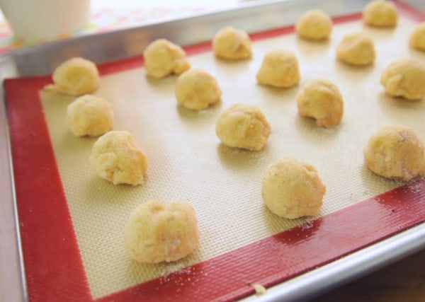 vegan dairy free snickerdoodle cookie dough balls on a baking mat
