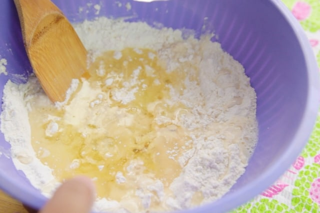bread being mixed with oil and water