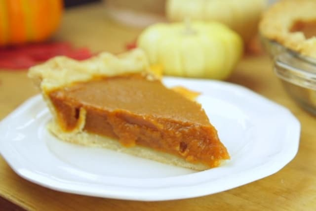 a slice of baked vegan pumpkin pie