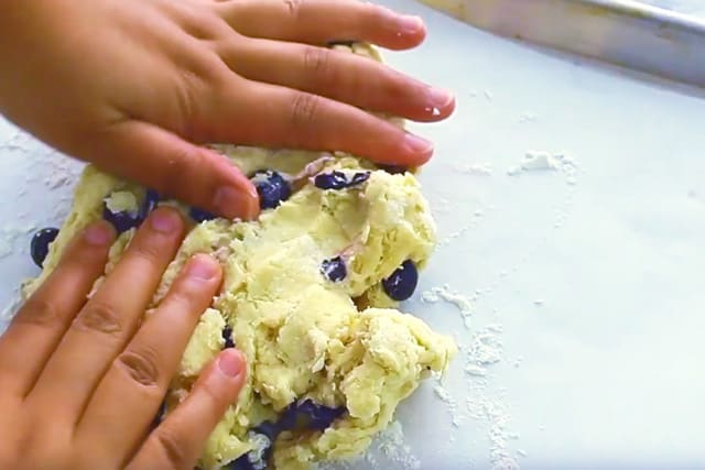 kneading the blueberry scone dough and added in fresh blueberries