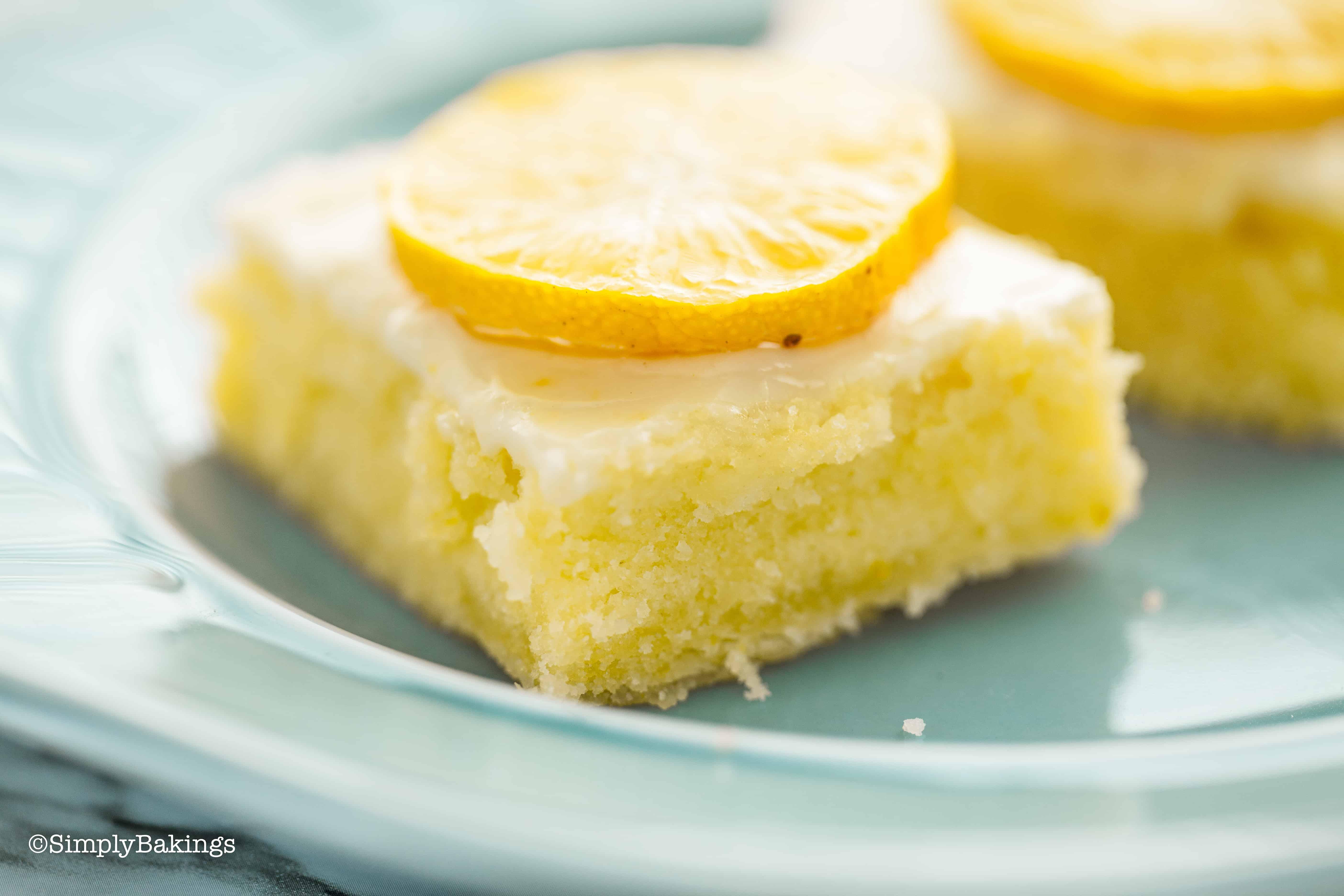 2 lemon brownies on a blue plate