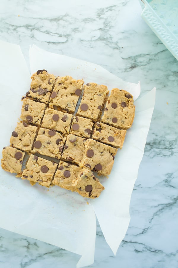 slices of freshly baked vegan blondies on parchment paper