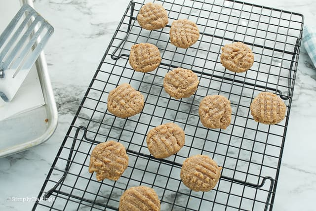freshly baked keato peanut butter cookies on a cooling rack