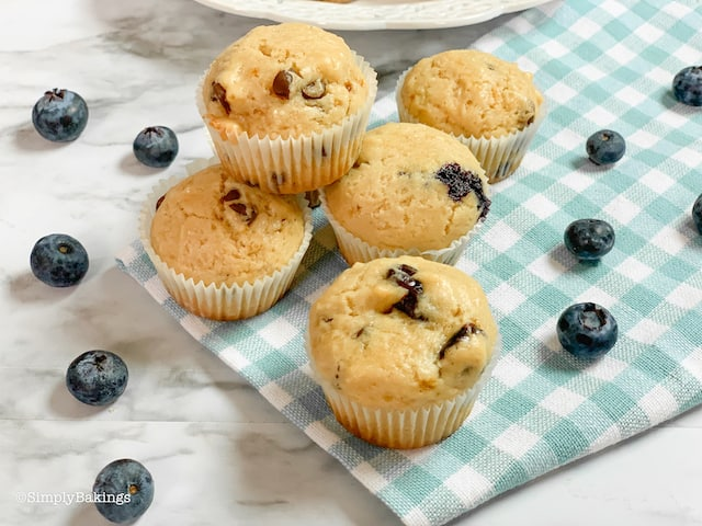 freshly baked healthy vegan muffins in three different variants - cranberries, blueberries and chocolate chips