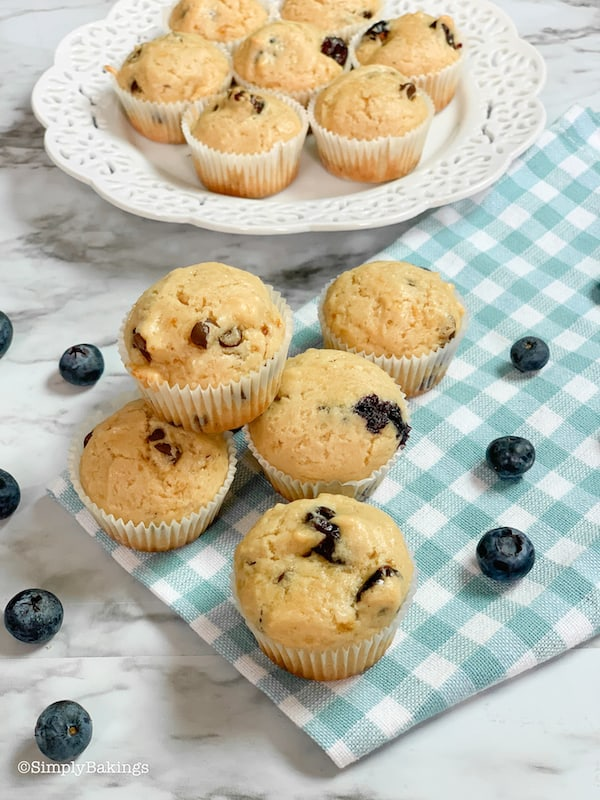 freshly baked healthy vegan muffins on a checkered cloth and white plate