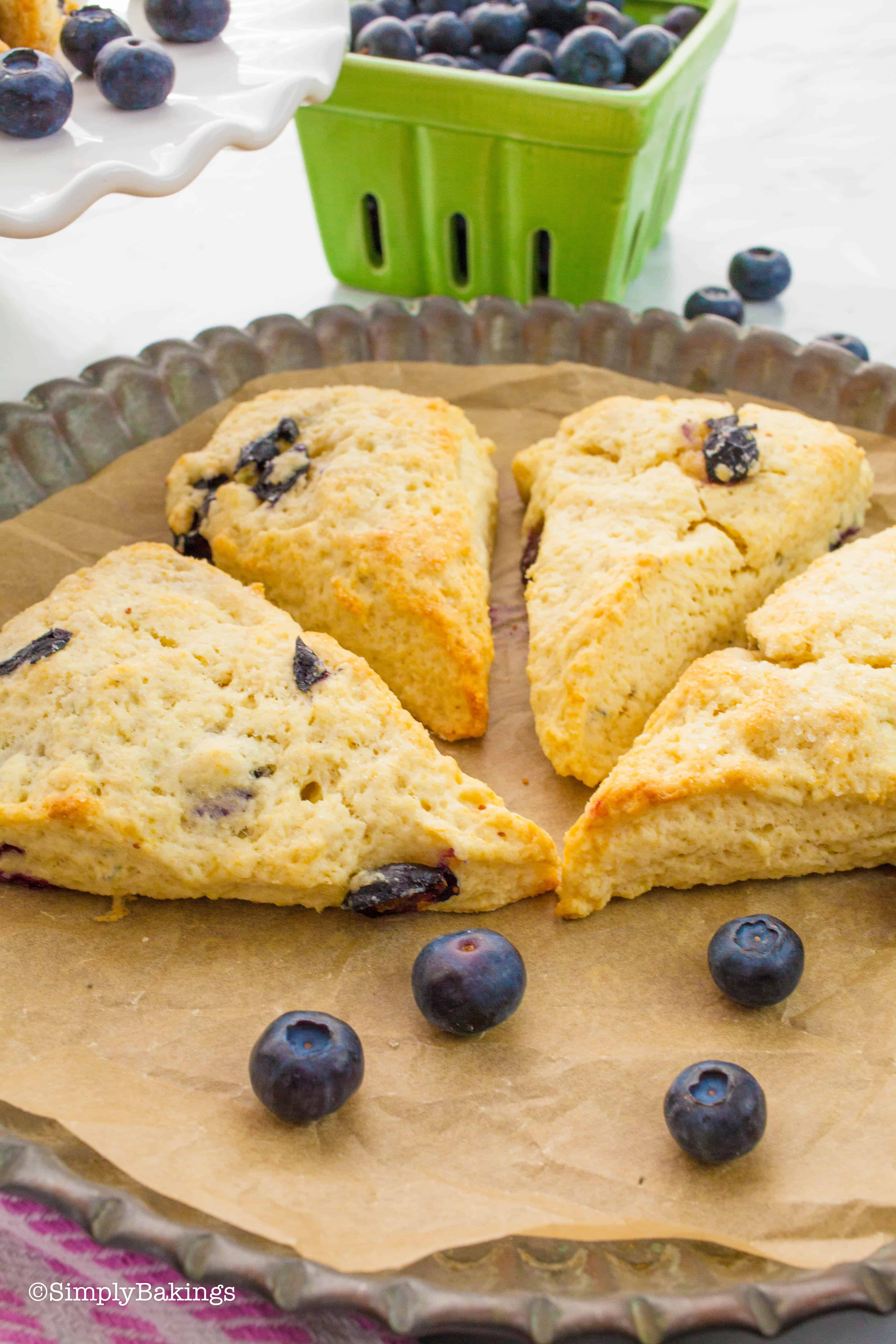 slices of freshly baked blueberry scones on a round tin platter