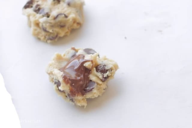 putting the nutella in the center of the cookie dough
