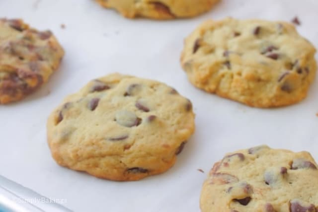 freshly baked nutella stuffed cookies in a baking tray