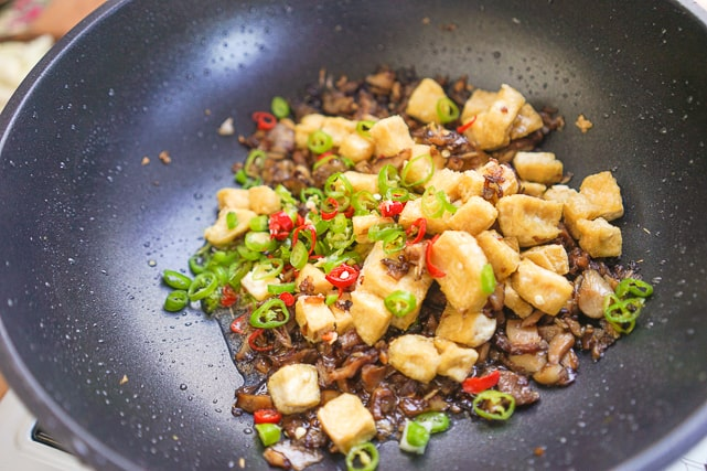 adding sliced chili or green and red peppers to the tofu sisig