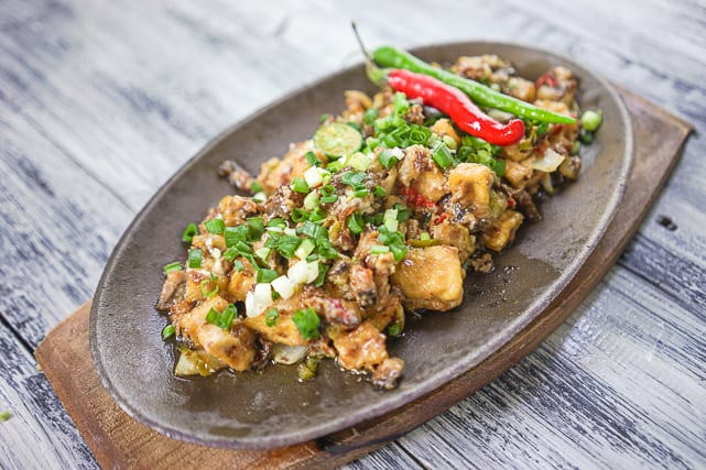 healthy and delicious tofu sisig on a sizzling plate