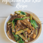 vegan kare kare in a white bowl