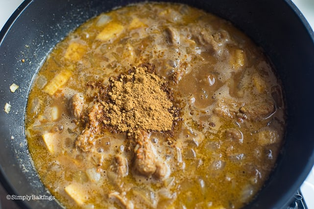 adding annatto powder and bean paste to the vegan kare kare