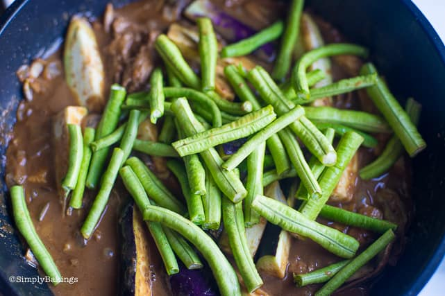 adding string beans and eggplants to the vegan kare kare
