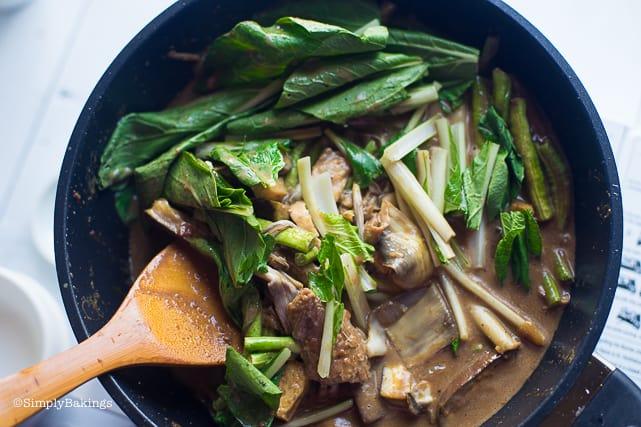 adding in bokcoi to the vegan kare kare