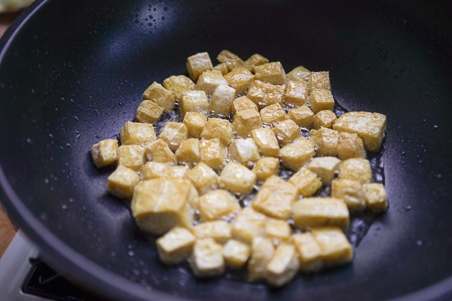 frying tofu cubes for tofu sisig recipe