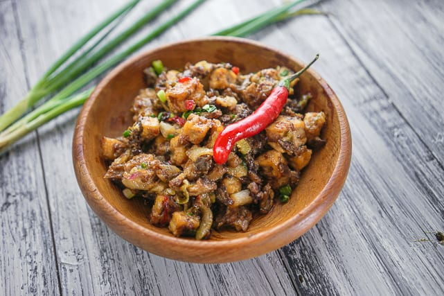 a bowl of tofu sisig with red chili on top
