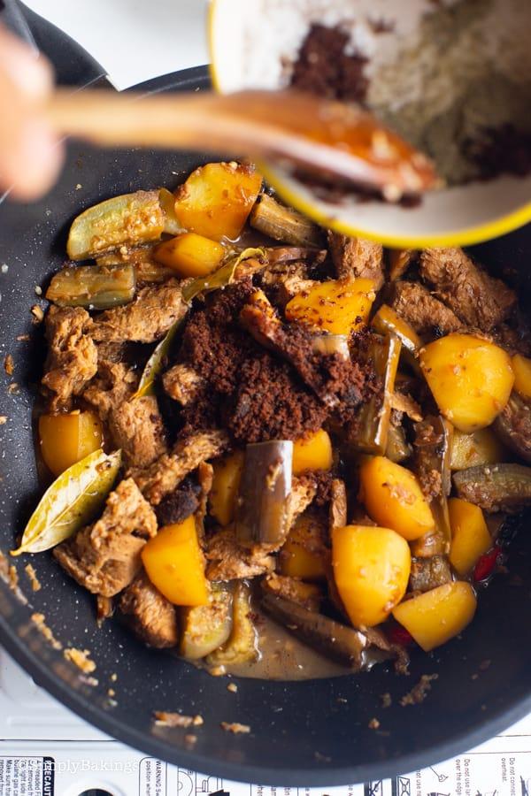 seasoning the vegetarian Filipino Chicken adobo with dark brown sugar