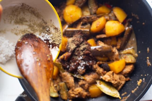 seasoning the vegetarian Filipino Chicken Adobo with salt and pepper