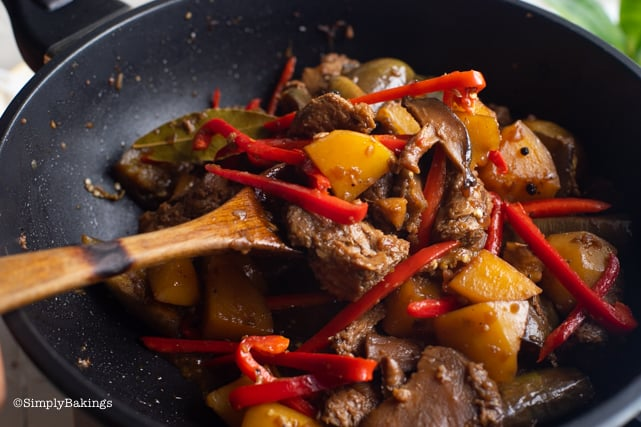 adding the sliced red bell peppers to the vegetarian Filipino Chicken Adobo