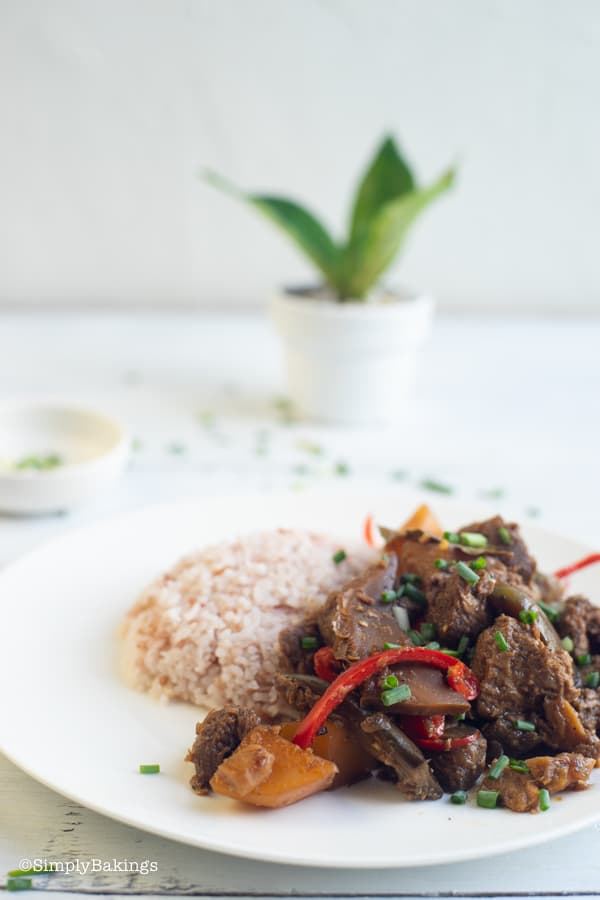 vegetarian Filipino Chicken Adobo with brown rice on a white plate