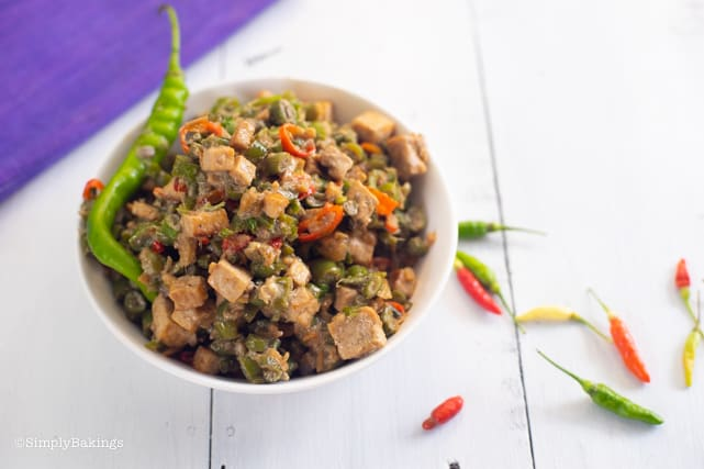overhead photo of vegetarian Bicol Express on a white plate with chilis