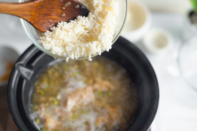 adding in the sticky rice for the congee recipe