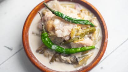 cooked vegetarian ginataang gabi in a wooden bowl