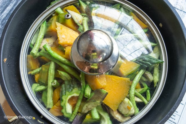 covering the pot with lid to tenderize the vegetables for Pinakbet recipe