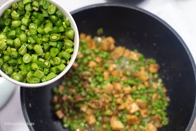 adding in the Baguio beans to the tofu and string beans