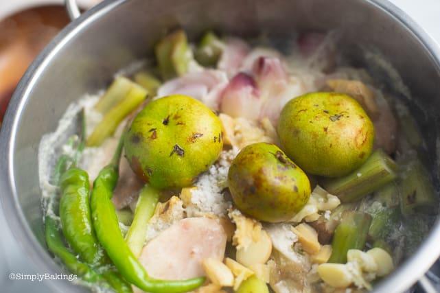 adding batwan to the vegetarian ginataang gabi ingredients