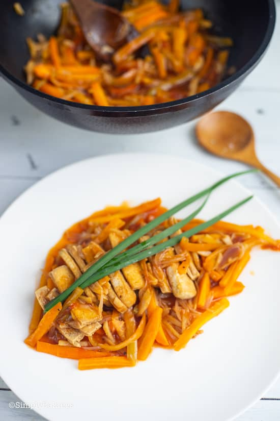 delicious Filipino Vegan Escabeche on a white plate with spring onions on top