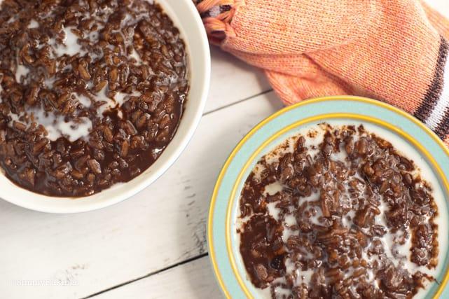 two bowls of vegan filipino champorado with almond milk