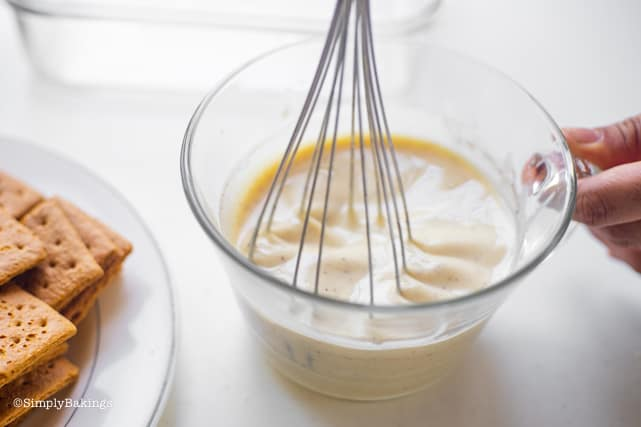 mixing the mango float cream using a wire whisk