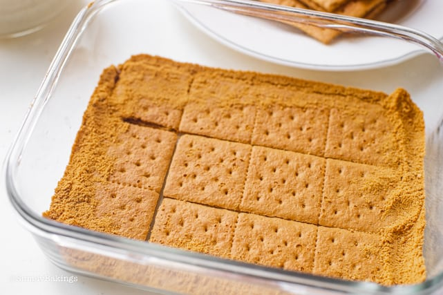 arranging the honey graham crackers and graham crumbs for the mango float recipe