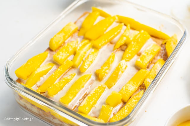adding sliced mangoes on the last layer of the mango float