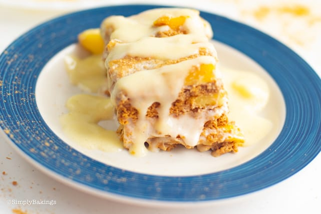 mango float slice on a plate drizzled with milk and cream