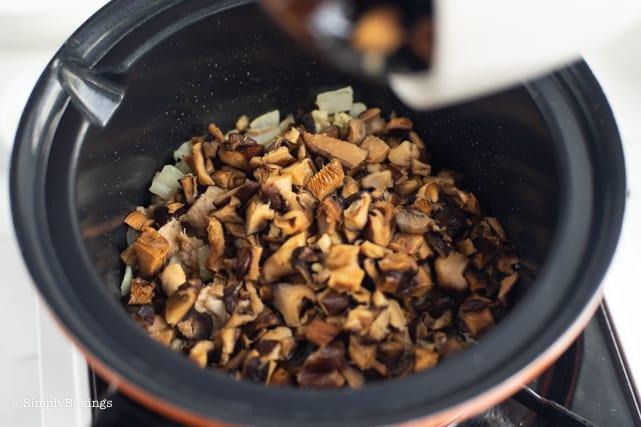 sauteing the shitake mushrooms