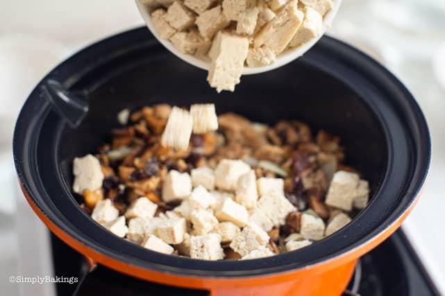 adding the tofu for the vegan dinuguan